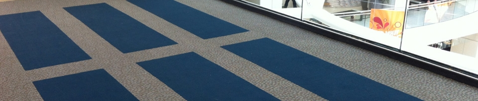 Do You Know the Difference Between Inlaid and Printed Logos on Commercial Door Mats?